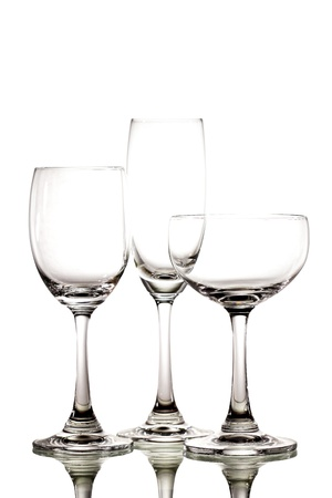Three empty glass on white background photo