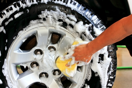 Clean tires with foam and shampoo photo