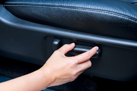 Electric seat control by hand Stock Photo