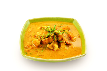 fish plate: Yellow curry with fish and spicy on a white background