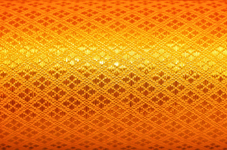 thai culture: Close up Thai art pattern on gold silk texture