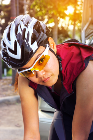 girl sport: Young woman warm body before cycling,sport background