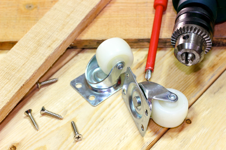 electric drill: Electric drill with metal wheel on wooden scenery Stock Photo
