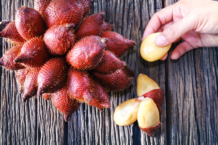 Close up Salak fruits on wood table,Thai and Indonesian local fruits