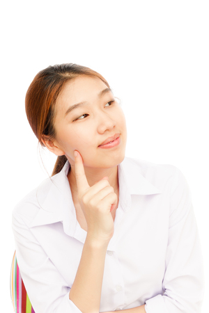 to contemplate: A beautiful young businesswoman thinking against on white background Stock Photo