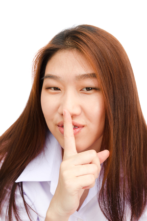 Closeup portrait of an Asian young business woman making silent gesture isolated on a white background Stock Photo