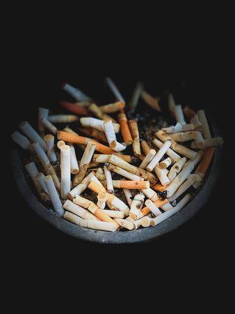 Close up Ashtray cigarette in dark scene wallpaper backgrounds