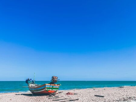 Fishing boat on the beach nature tropical island backgrounds Stock fotó