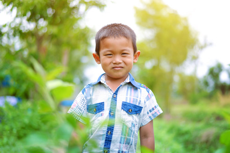 Portrait of young boy in nature, park or outdoors. cute kid outdoor. a child is smiling enjoying adopted life.