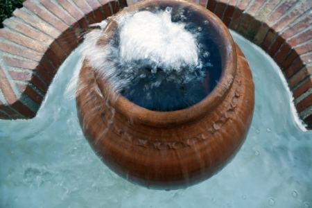 natural fountain in typical andalusian village photo