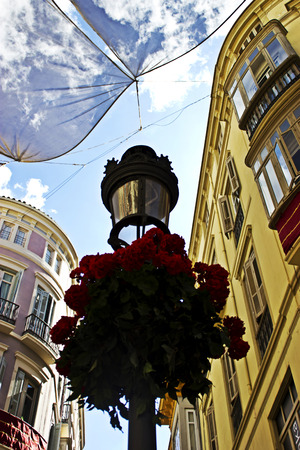 Lampost with plant pot in famous street in malaga photo