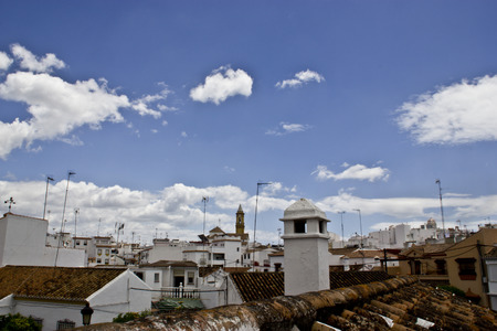 andalusian: Typical white andalusian village in malaga with cloudly sky