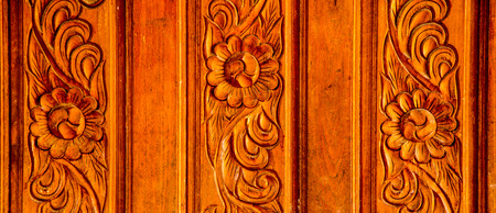 Wood carving holes through flowers photo