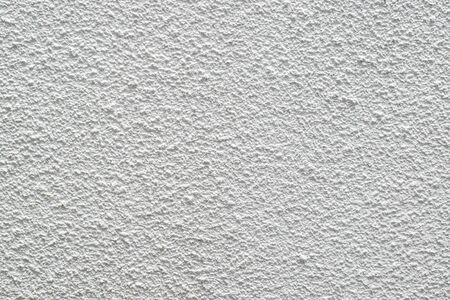 White Stucco Texture Background of a Dry Stone Wall