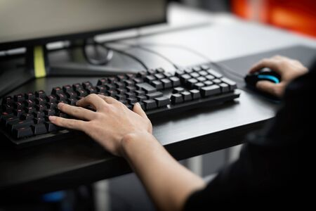 the hand of a man playing a computer game 写真素材