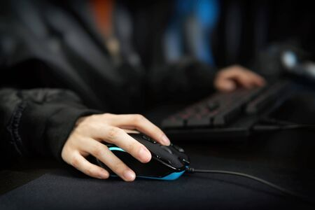 The hand of the woman who playes the personal computer game