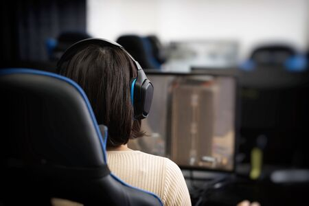 A woman who chats by voice in an online game