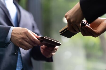 Up the hands of businessmen exchanging business cards Stock Photo