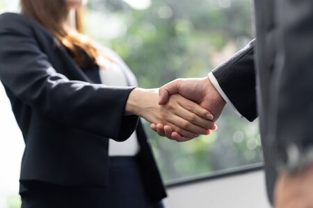 Handshake between a male businessman and a female businesswoman Standard-Bild - 134775169