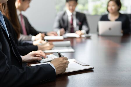 businessmen meeting in bright meeting rooms Standard-Bild - 134775174