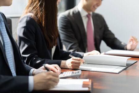 businessmen meeting in bright meeting rooms Standard-Bild - 134775181