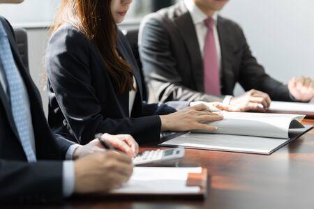 businessmen meeting in bright meeting rooms