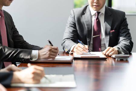 businessmen meeting in bright meeting rooms Standard-Bild - 134775183