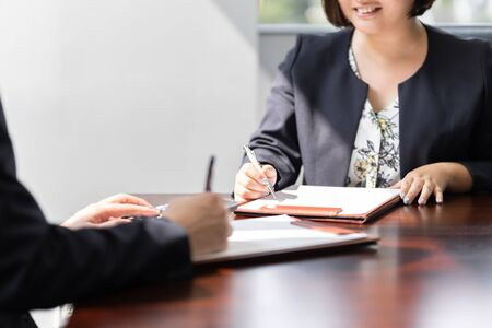 Businessmen and businesswomen meeting in bright meeting rooms Standard-Bild - 134775474