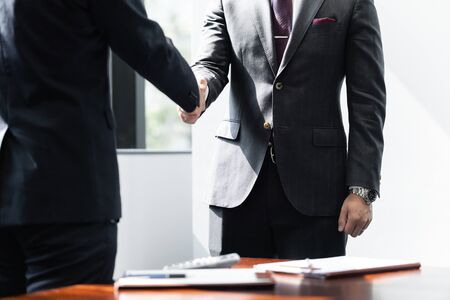Handshake between male businessmen Standard-Bild - 134775473