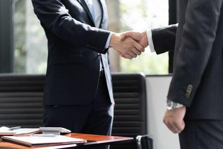 Handshake between male businessmen Standard-Bild - 134775476