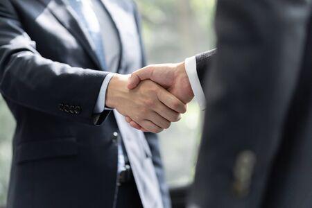 Handshake between male businessmen Standard-Bild - 134775478
