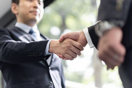 Handshake between male businessmen Standard-Bild - 134775477
