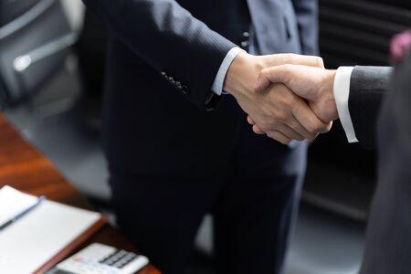 Handshake between male businessmen Standard-Bild - 134775480