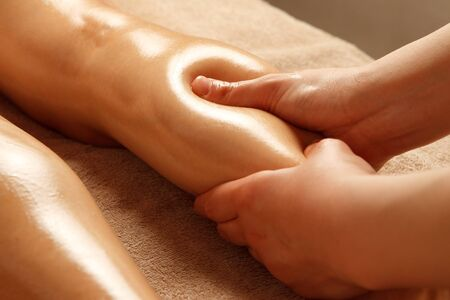 Esthetician's hand sheds calf lymph in beauty salon 写真素材