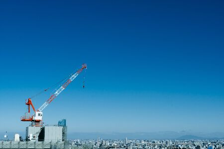 Construction of high-rise buildings and blue sky
