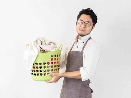 The image of a man who is troubled by the accumulated laundry