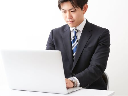 A man who operates a business image computer