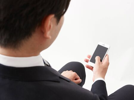A man who operates a business image smartphone