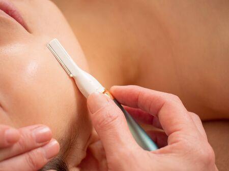 Facial shaving before light hair removal Stock fotó - 138332408