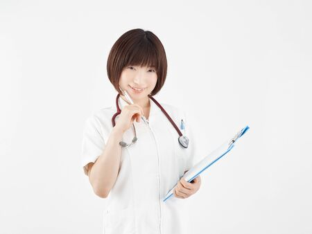 Female nurse who accepts with a smile in white background Stock fotó