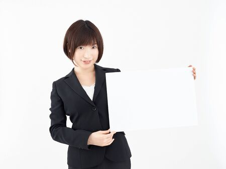 Female OL with white board in white background Stock Photo