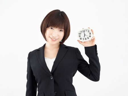 Female OL with 7 o'clock clock in white background