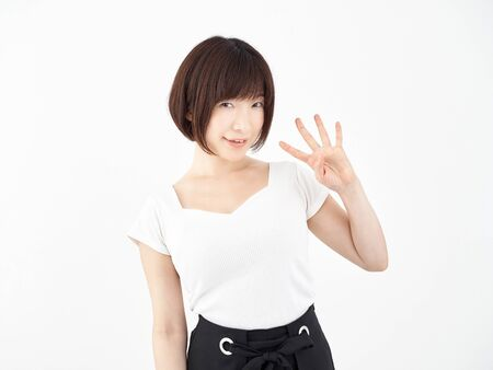 a woman posing 4 with her fingers on a white background