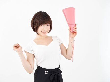 Woman cheering with megaphone on white background