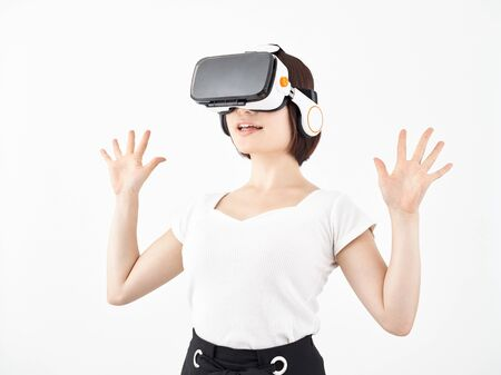 Woman surprised with VR head-mounted display with white background
