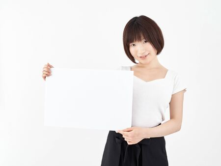 Woman with white board on white background