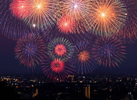 The image of fireworks that rise stown up in the town at night