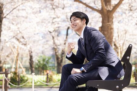 Japanese male businessman in guts pose