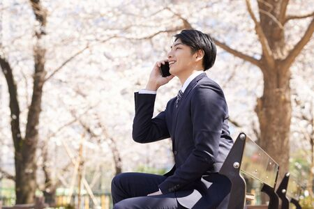 Japanese male businessman who calls with a smile Banco de Imagens