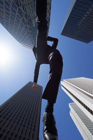 Japanese male businessman jumping in office district